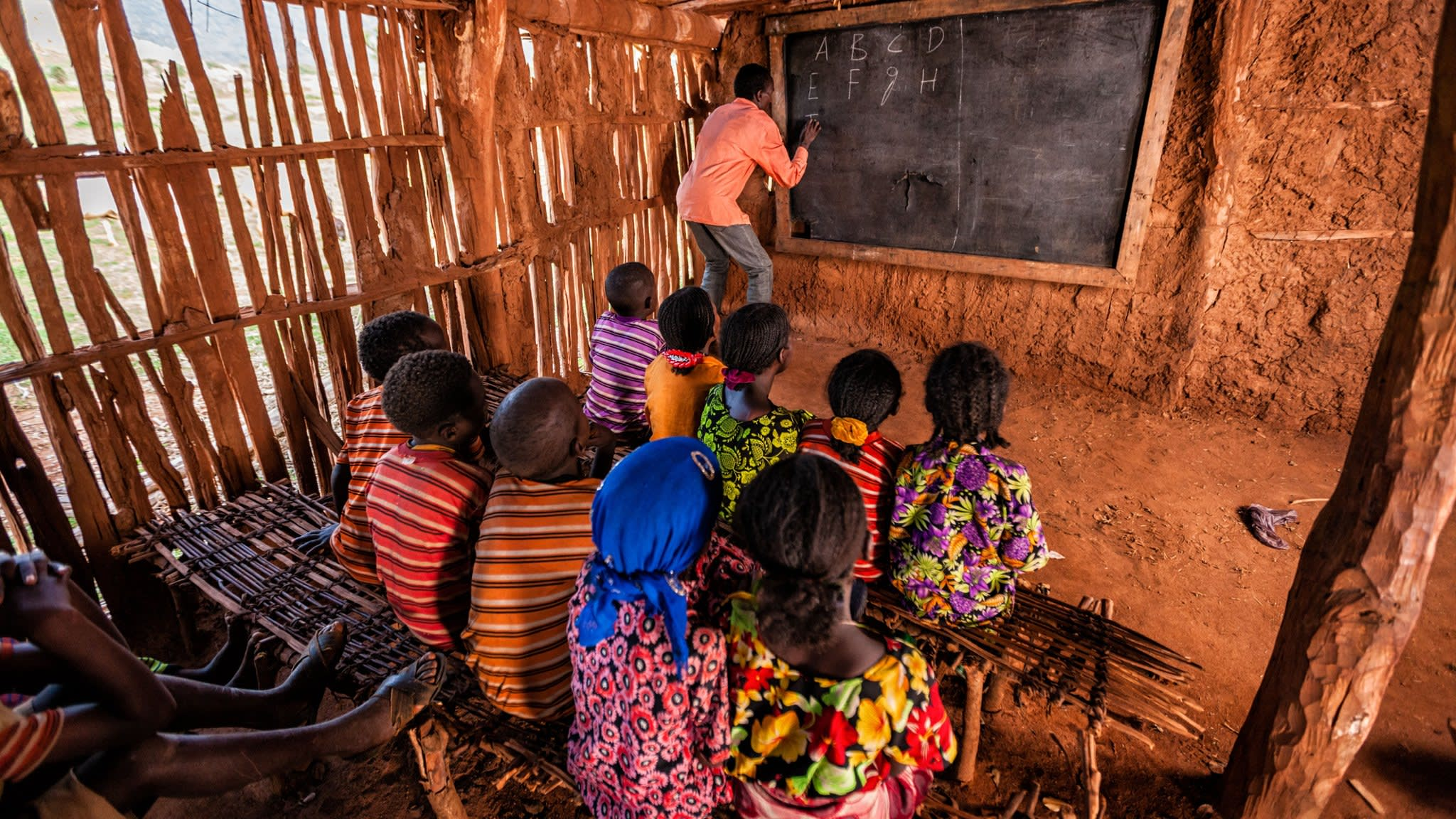 African children during english class in very remote school.