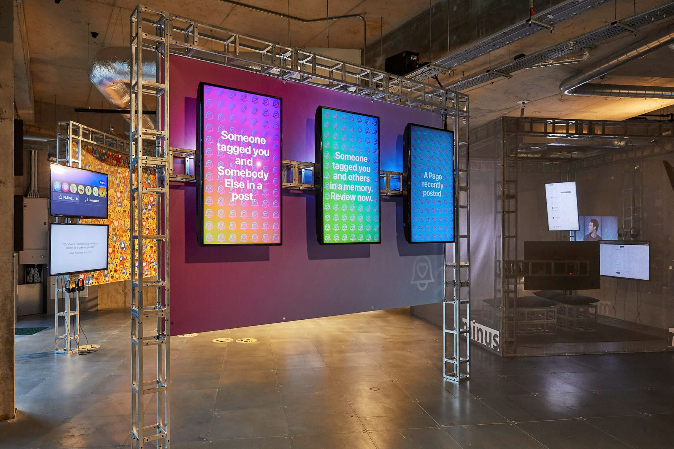 Several digital screens with bright colour gradations in a gallery
