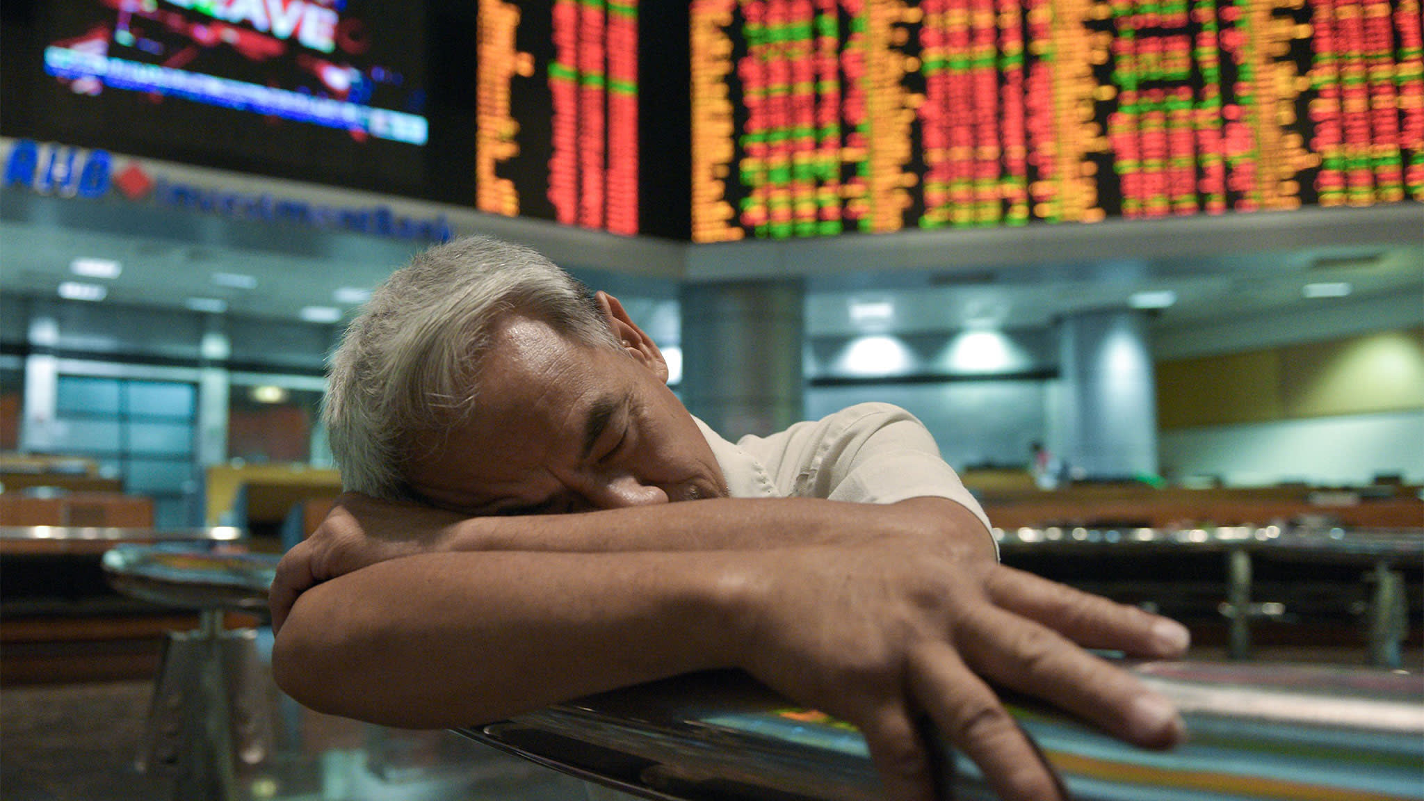 The work catches up with a trader at the Malaysia stock exchange in Kuala Lumpur