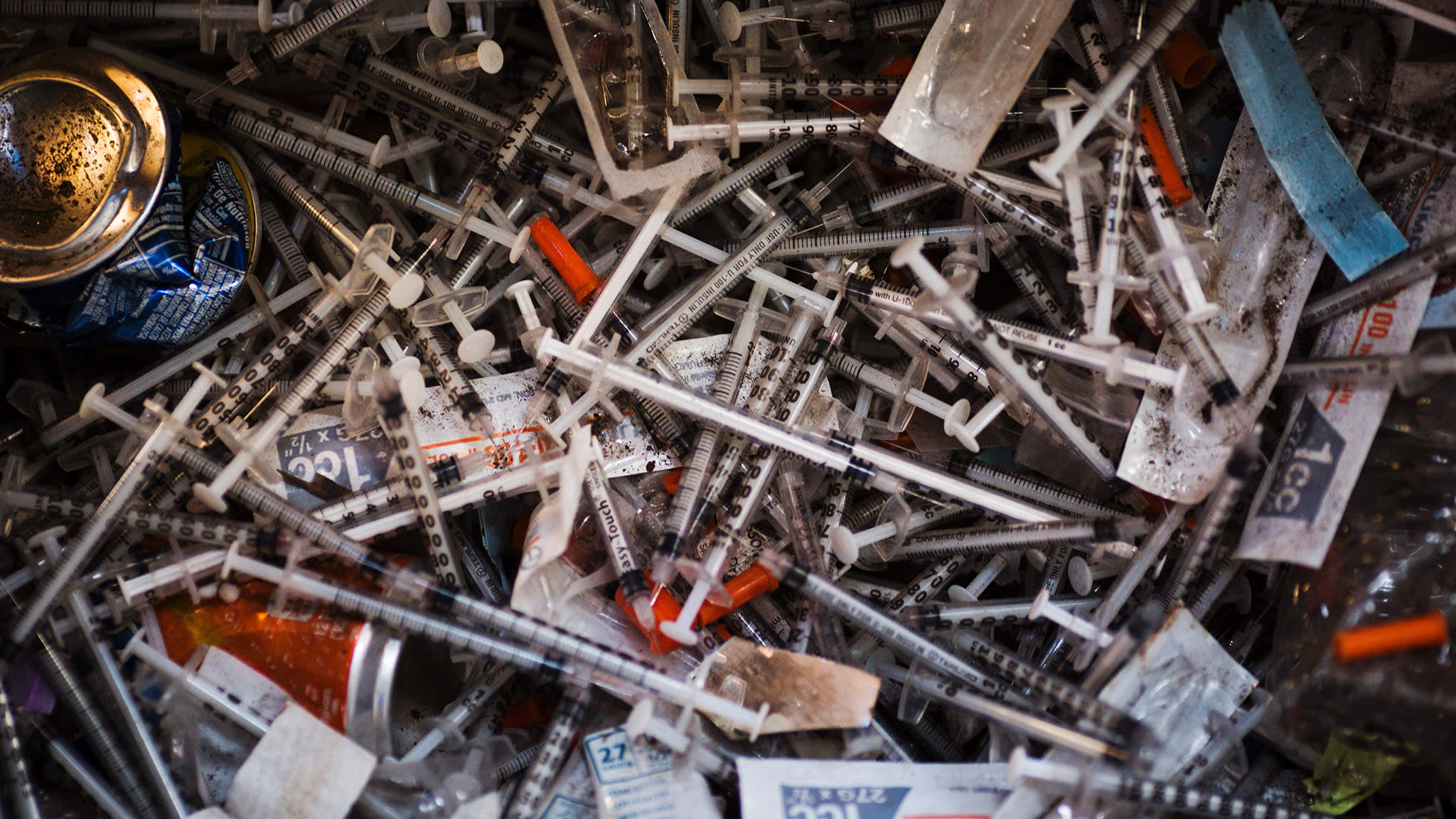 Discarded needles are seen at a heroin encampment in the Kensington neighborhood of Philadelphia, Pennsylvania, on April 7, 2017.In North Philadelphia, railroad gulch as it is knowen, is ground zero in Philadelphia?s opioid epidemic. Known by locals as El Campanento, the open air drug market and heroin encampment is built with the discarded materials from the gulch and populated by addicts seeking a hit of heroin to keep their dope sick, or withdrawal symptoms, at bay. In one area, near the 2nd Avenue overpass, empty syringe wrappers blanket the refuse like grass the used needles they once contained poking through like thistles. / AFP PHOTO / DOMINICK REUTER        (Photo credit should read DOMINICK REUTER/AFP/Getty Images)