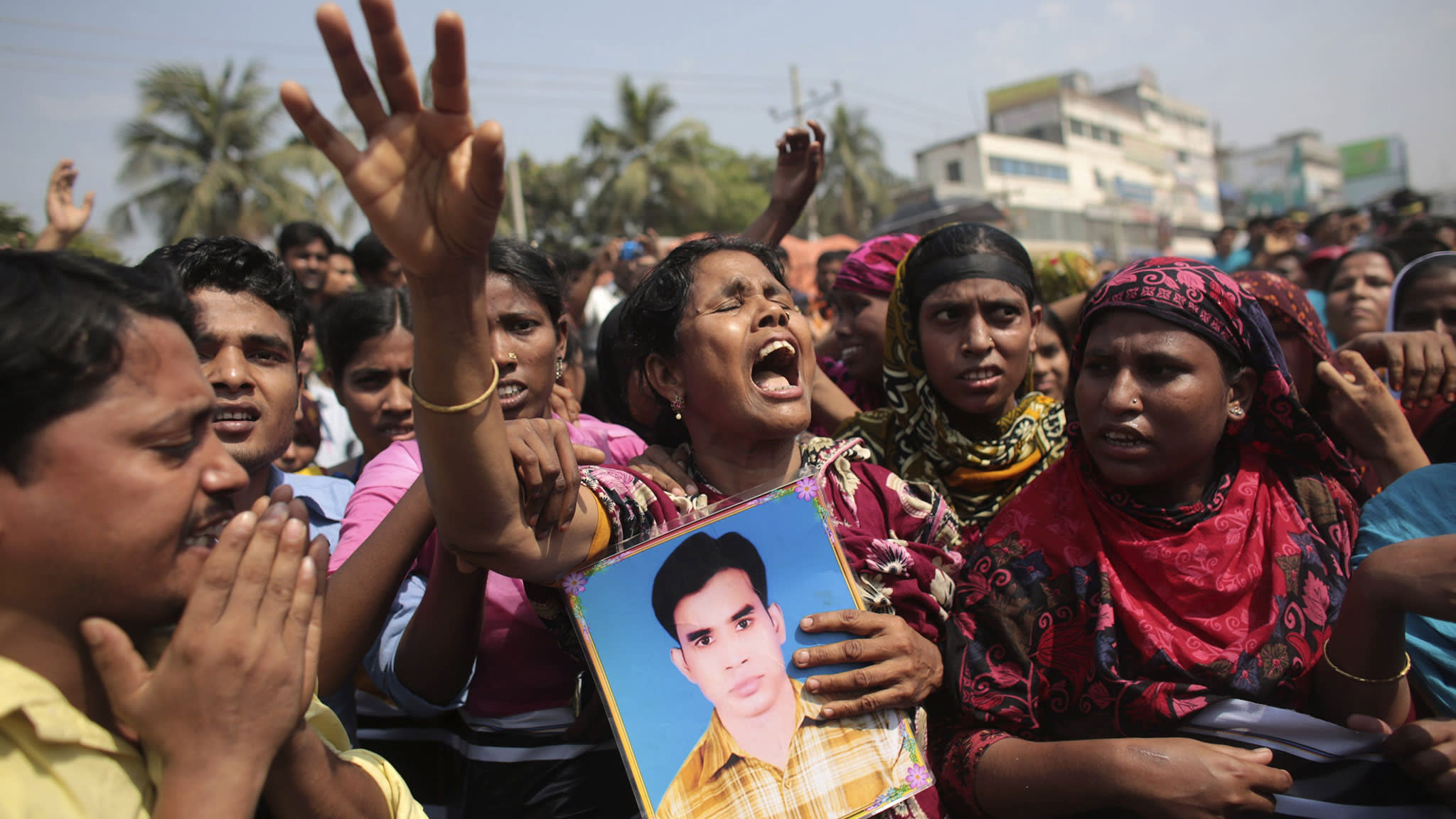 Protesters and relatives of the victims of the Rana Plaza disaster demand compensation