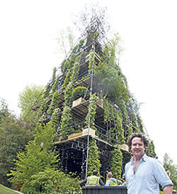 Diarmuid Gavin stands next to his Pyramid Garden, which starred at Chelsea in 2012