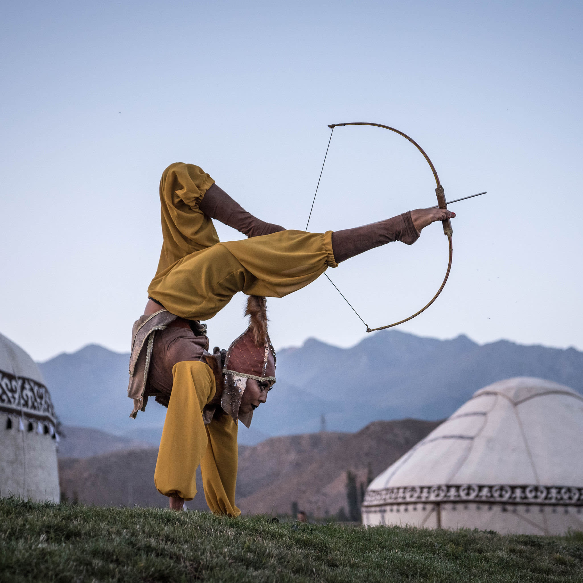 A performer shoots a bow and arrow with her feet at the World Nomad Games in September
