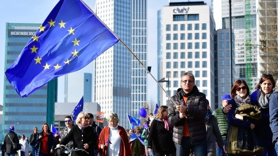 """FRANKFURT AM MAIN, GERMANY - MARCH 12: Around 3.500 People attend a pro-EU demonstration of the """"Pulse of Europe"""" movement on March 12, 2017 in Frankfurt, Germany. The movement sprung up in 2016 after the Brexit referendum result and the election of U.S. President Donald Trump as a pro-European voice to counter isolationist, right-wing movements across Europe. The movement is gaining momentum and today organized gatherings in approximately 40 cities throughout Europe. (Photo by Thomas Lohnes/Getty Images)"""