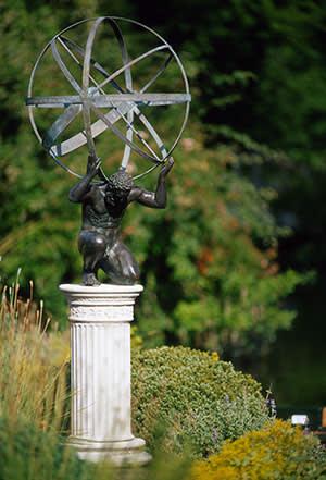 Brass dial on bronze Atlas