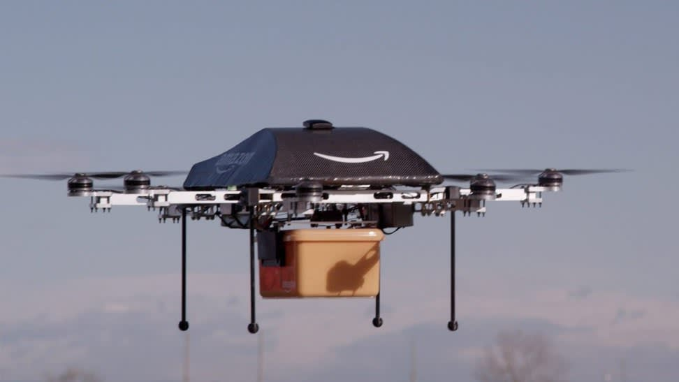 Amazon experimenting with delivery by drones, chief executive says...epa03974235 A undated handout image made available by Amazon on 02 December 2013, showing an octocopter drone with an Amazon logo on it, transporting a box. Online retailer Amazon is testing drones to deliver packages, chief executive Jeff Bezos said 01 December 2013 but admitted it could be several years before they would be put to use. The so-called octocopter would be able to deliver packages to consumers within 30 minutes, Bezos told broadcaster CBS' programme 60 Minutes Sunday. The unmanned aerial devices would only be used for small, urgent orders to be delivered within short distances, he said. The eight-propeller drones could transport packages weighing up to 2.5 kilograms and about 16 kilometres away from a distribution centre, Bezos said. But more testing was needed, he said, as well as the approval of the US Federal Aviation Administration. And while Bezos expected to offer the service only in four to five years, he already has a name for it: Prime Air. EPA/AMAZON / HANDOUT HANDOUT EDITORIAL USE ONLY/NO SALES