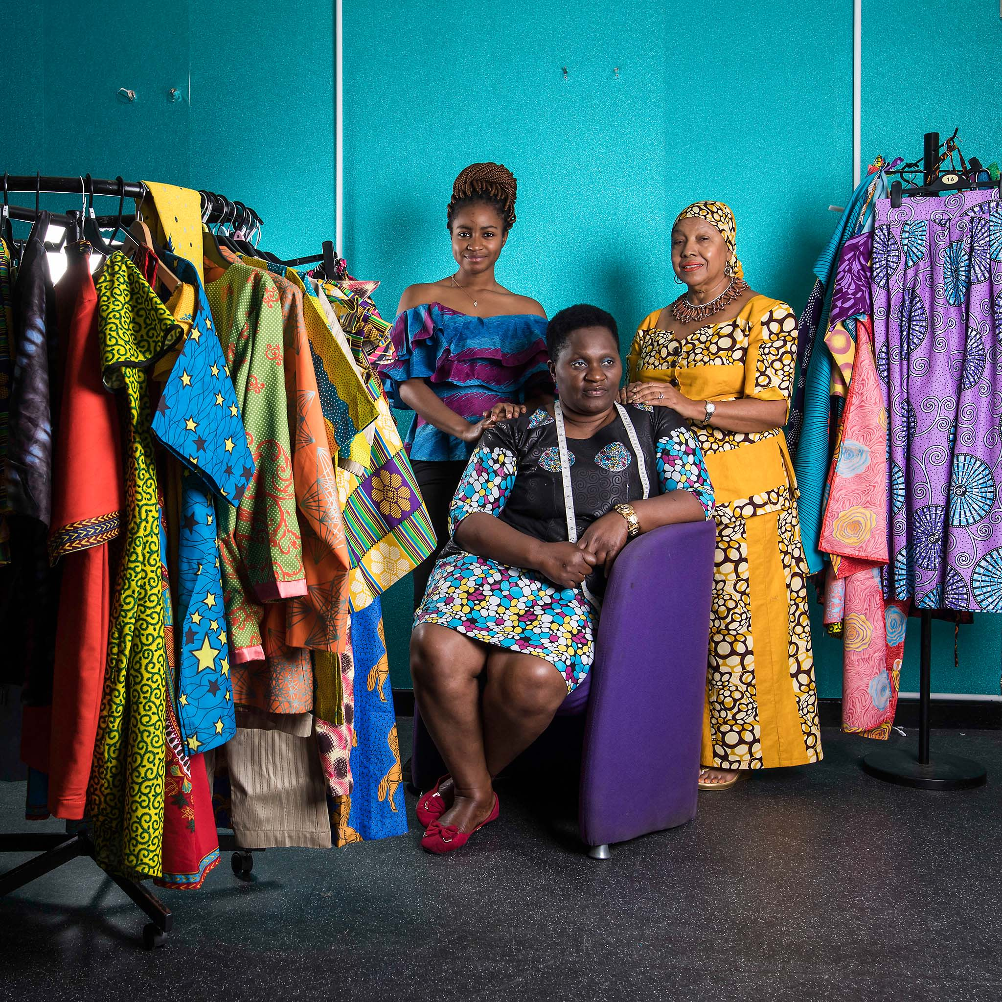 Faith Gakanje, centre, runs her own clothing business and mentors other migrants as they start their own ventures