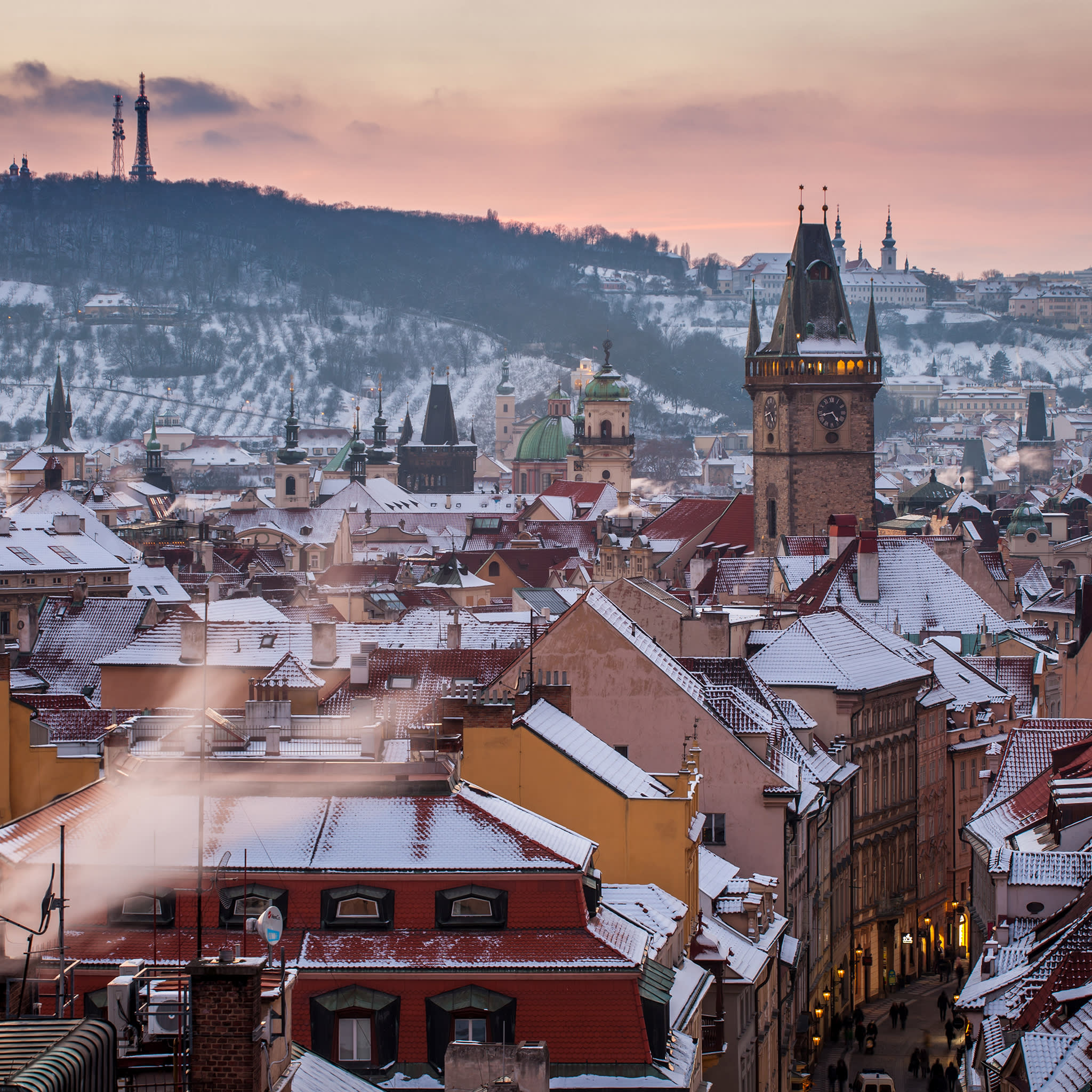 Prague in winter, with a view of the Church Of Our Lady Before Týn, the Old Town Hall and Prague Castle