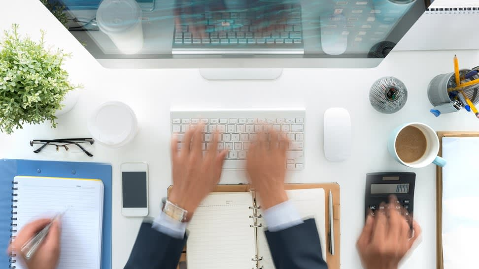 Hands of business person working at his table, blurred motion