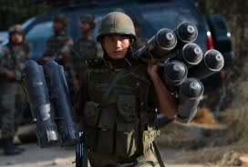 An Indian soldier carries ammunition after a gun battle with suspected militants in Indian Kashmir last week