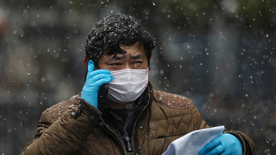 Coronavirus latest: China's Hubei province reports almost 2,000 new cases