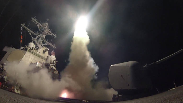 epa05894269 A handout photo made available by the US Navy Office of Information shows the guided-missile destroyer USS Porter (DDG 78) launching a missile strike while in the Mediterranean Sea, 07 April 2017. The United States military launched at least 50 tomahawk cruise missiles against al-Shayrat military airfield near Homs, Syria, in response to the Syrian military's alleged use of chemical weapons in an airstrike in a rebel held area in Idlib province on 04 April 2017. EPA/FORD WILLIAMS / HANDOUT HANDOUT EDITORIAL USE ONLY/NO SALES