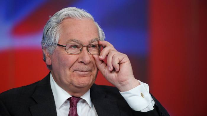 Mervyn King, former governor of the Bank of England, adjust his glasses before a Bloomberg Television interview in London, U.K., on Wednesday, April 20, 2016. King added to calls by central bankers to recognize that monetary policy is close to its limit, saying the world faces a