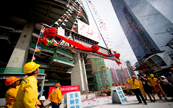 The last metal panel is raised into position during the 'topping out' ceremony in August for the 632-metre Shanghai Tower