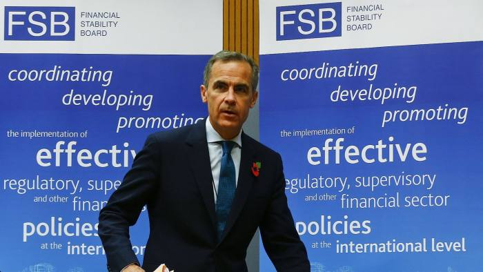 Bank of England Governor and Financial Stability Board (FSB) Chairman Mark Carney arrives for a news conference at the Bank for International Settlements (BIS) in Basel November 10, 2014. REUTERS/Arnd Wiegmann (SWITZERLAND - Tags: POLITICS BUSINESS)