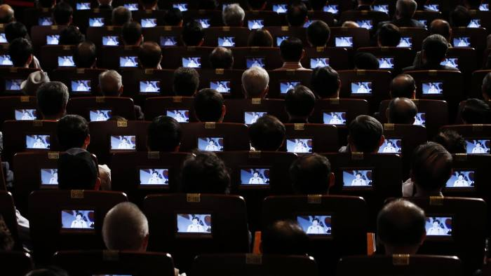 Participants watch South Korean President Park Geun-hye delivering a speech on small screens fitted in their seats during a ceremony marking the 69th anniversary of liberation from Japan's 1910-45 colonial rule, on Liberation Day in Seoul August 15, 2014. REUTERS/Kim Hong-Ji (SOUTH KOREA - Tags: POLITICS ANNIVERSARY CONFLICT) - RTR42HRB