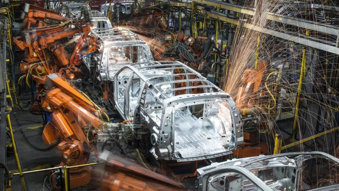 Robotic machines weld together the frames of sports utility vehicles (SUV) during production at the General Motors Co. (GM) assembly plant in Arlington, Texas, U.S., on Thursday, March 10, 2016. The U.S. Census Bureau is scheduled to release business inventories figures on March 15. Photographer: Matthew Busch/Bloomberg
