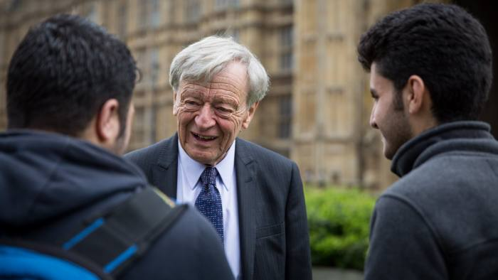 LONDON, ENGLAND - APRIL 25: Lord Alf Dubs speaks to two child refugees from Syria on College Green on April 25, 2016 in London, England. A vote on the Labour peer's amendment to the Immigration Bill, which could see 3,000 unaccompanied refugee children in Europe be granted entry to the United Kingdom, takes place in Parliament today. The photo call was organised by Citizens UK, a charity working to persuade councils to participate in resettling Syrian refugees. (Photo by Rob Stothard/Getty Images)