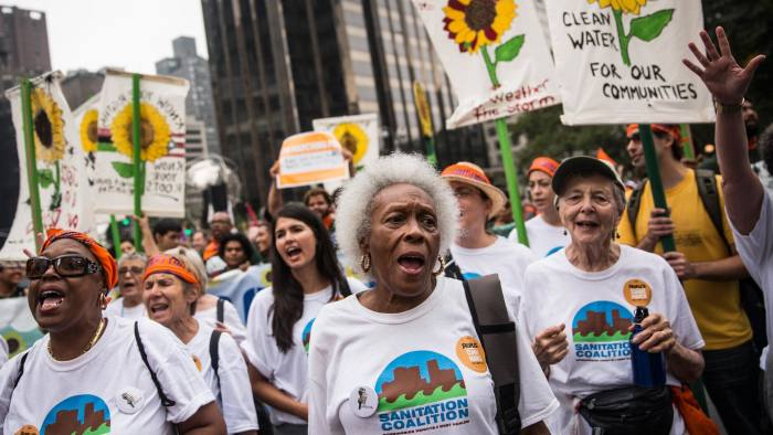 NEW YORK, NY - SEPTEMBER 21:  People protest for greater action against climate change during the People's Climate March on September 21, 2014 in New York City. The march, which calls for drastic political and economic changes to slow global warming, has been organized by a coalition of unions, activists, politicians and scientists.  (Photo by Andrew Burton/Getty Images)