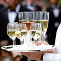 drinks waiter serving champagne and wine 			Dreamstime