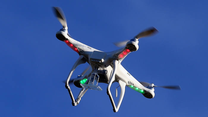 A drone is flown for recreational purposes in the sky above Syosset, New York on August 30, 2015