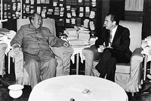 The historic meeting between Richard Nixon and Mao Zedong in 1972, which marked the resumption of relations between the two powers