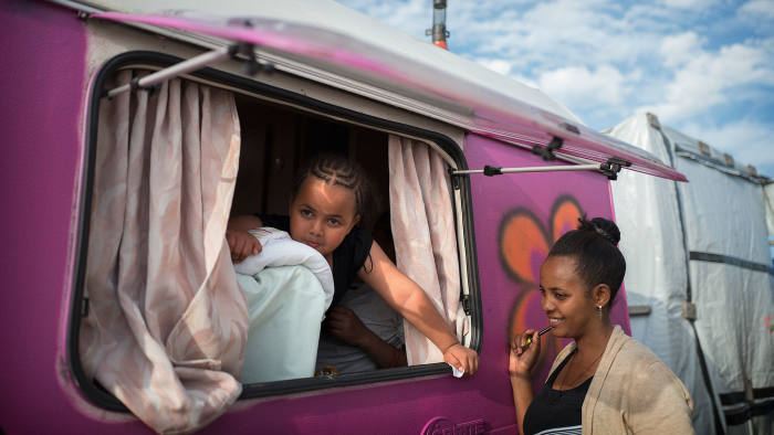 Yabsira's daughter, left, in the caravan she shared with her mother in the Calais Jungle