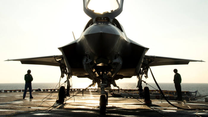 The flight deck crew secures an F-35B Lighting II aircraft aboard the amphibious assault ship USS Wasp following testing in this handout photo taken off the coast of North Carolina August 24, 2013. The US is having a military build up before strikes on Syria.