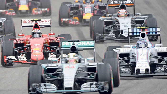 Drivers compete at the start of the Russian Formula One Grand Prix at the Sochi Autodrom circuit on October 11, 2015