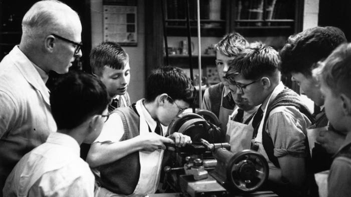 4th December 1954: Boys learning to use machine tools during a lesson at Manchester Grammar School. Original Publication: Picture Post - 7424 - The Education Money Can't Buy - pub. 1954 (Photo by Bert Hardy/Picture Post/Getty Images)