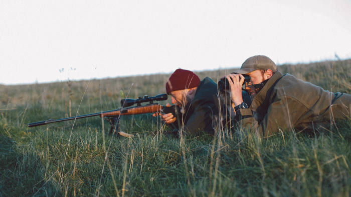 Tim Hayward (left) lines up his target with the help of shooting instructor Chris Wheatley-Hubbard