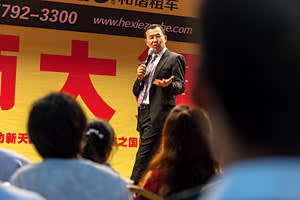Motivational speaker Zhang Bing on stage