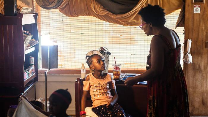 Sugar Momma: the girls' grandmother applies false eyelashes to Shania