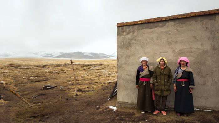 Tibetan women outside their home on the grassland, Qinghai province