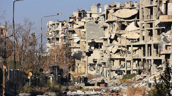TOPSHOT - Destruction is seen in Aleppo's Bustan al-Basha neighbourhood on November 28, 2016, during Syrian pro-government forces assault to retake the entire northern city from rebel fighters. Government forces have retaken a third of rebel-held territory in Aleppo, forcing nearly 10,000 civilians to flee as they pressed their offensive to retake Syria's second city. In a major breakthrough in the push to retake the whole city, regime forces captured six rebel-held districts of eastern Aleppo over the weekend, including Masaken Hanano, the biggest of those in eastern Aleppo. / AFP PHOTO / GEORGE OURFALIANGEORGE OURFALIAN/AFP/Getty Images