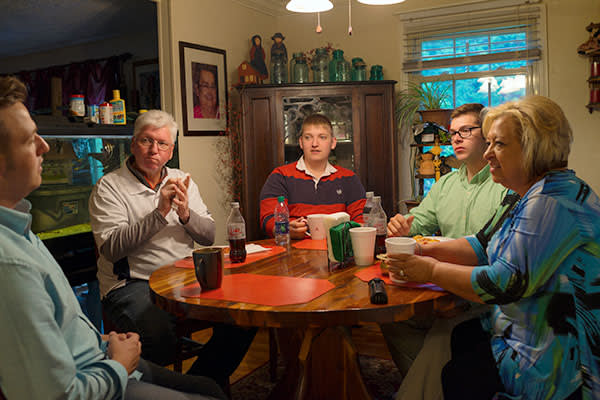 Daniel Justus, 22, (far L) with his father Danny, brother Josh, 19, brother Heath, 21, and mother Karen in their home in Hurley, Virginia on May 17, 2016.