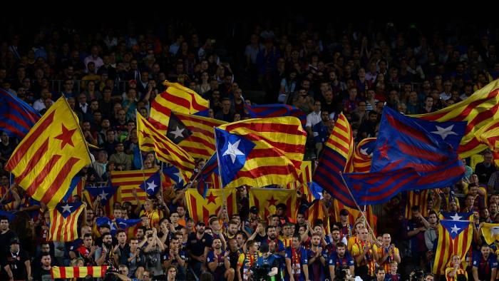 Barcelona's fans wave 'Esteladas' (pro-independence Catalan flags) before the UEFA Champions League Group D football match FC Barcelona vs Juventus at the Camp Nou stadium in Barcelona on September 12, 2017. / AFP PHOTO / Josep LAGO (Photo credit should read JOSEP LAGO/AFP/Getty Images)
