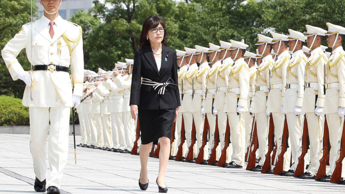 Tomomi Inada reviewing a guard of honour at the defence ministry last month