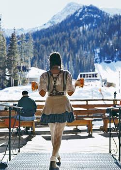 A waitress serves beer at the Bavarian