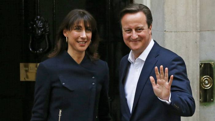 Britain's Prime Minister David Cameron waves as he arrives with his wife Samantha at Number 10 Downing Street in London...Britain's Prime Minister David Cameron waves as he arrives with his wife Samantha at Number 10 Downing Street in London, Britain May 8, 2015. Cameron's Conservatives are set to govern Britain for another five years after an unexpectedly strong showing, but may have to grapple with renewed calls for Scottish independence after nationalists surged. REUTERS/Phil Noble TPX IMAGES OF THE DAY