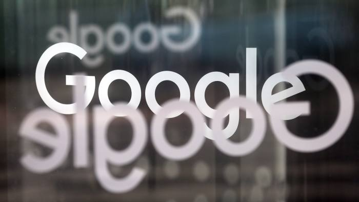 The Google Inc. company logo sits on revolving doors at the company's new U.K. headquarters at Six St Pancras Square in London, U.K., on Tuesday, June 21, 2016. The owner of the world's largest search engine built its new U.K. headquarters on 2.4 acres (1 hectare) of land that's part of a larger development by King's Cross Central LP near the Eurostar rail link to mainland Europe. Photographer: Chris Ratcliffe/Bloomberg