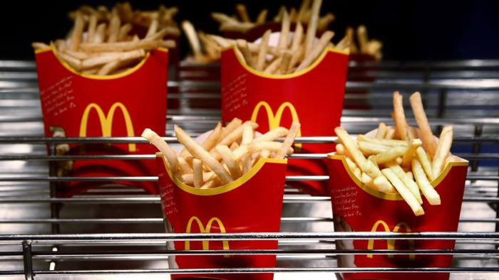 Cartons of McDonald's french fries sit at a restaurant in London, U.K., on Monday, Feb. 1, 2010. McDonald's Corp., the world's largest restaurant company, plans to increase its number of Russian outlets by 20 percent this year to capitalize on its fastest growing market in Europe. Photographer: Jason Alden/Bloomberg