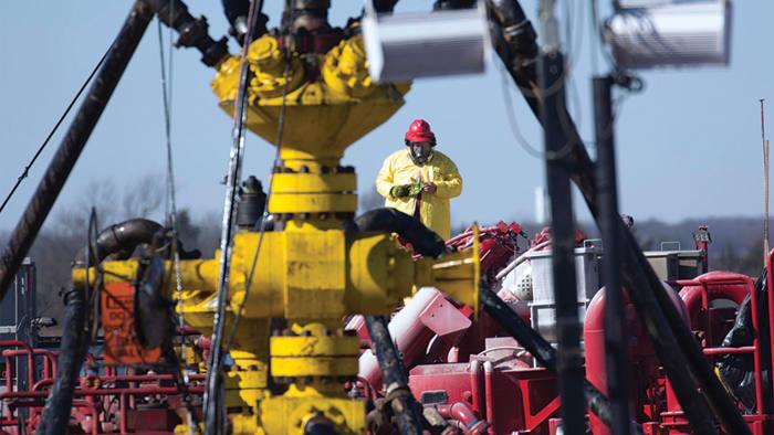 A Halliburton oil well worker at a fracking rig site near Stillwater, Oklahoma