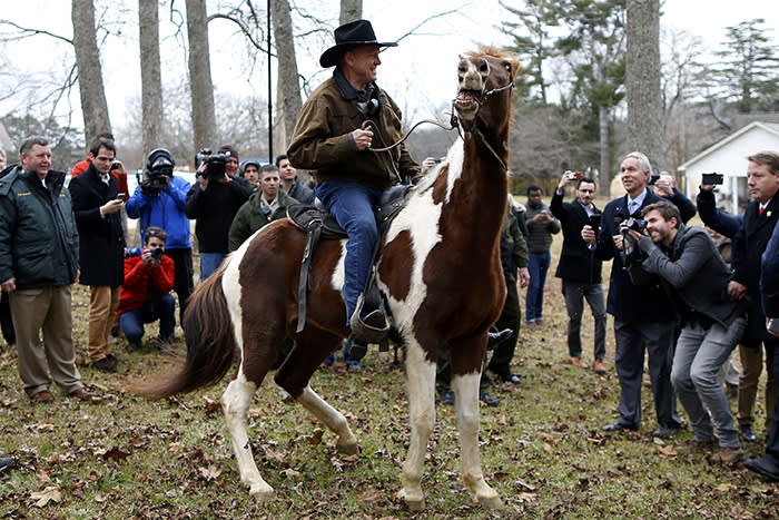 Republican candidate for U.S. Senate Judge Roy Moore rides his horse after voting in Gallant, Alabama, U.S., December 12, 2017. REUTERS/Jonathan Bachman