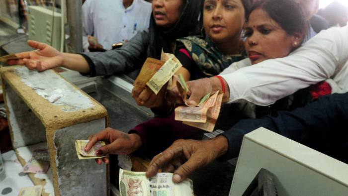 Indian passengers use 1000 and 500 rupee notes to purchase rail tickets at Allahabad Railway station in Allahabad on November 9, 2016. 		India's government tried to quell the panic caused by a bombshell decision to withdraw 500 and 1,000 rupee notes from circulation after cash machines ran dry and shares slid. / AFP PHOTO / sanjay kanojiaSANJAY KANOJIA/AFP/Getty Images