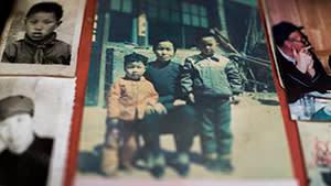 Zhang Xiantu with two of her grandchildren, and other family photographs