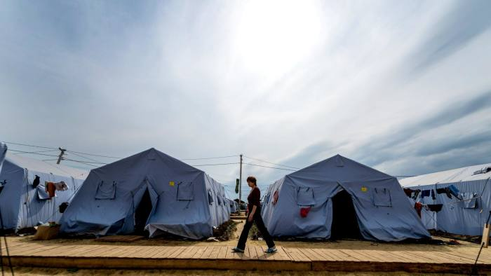 A refugee from eastern Ukraine walks in a refugee camp near the Russian city of Donetsk
