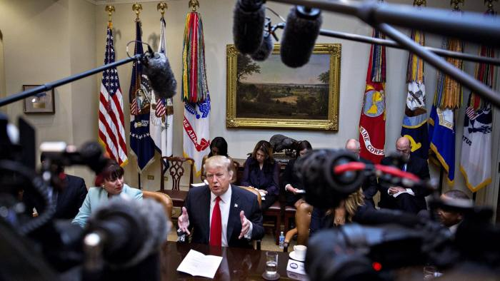 U.S. President Donald Trump, center, speaks as he meets with small business leaders in the Roosevelt Room of the White House in Washington, D.C., U.S., on Monday, Jan. 30, 2017. Trump defended the immigration clampdown that sparked a global backlash over the weekend by blaming the confusion at airports on protesters and on a computer outage at Delta Air Lines Inc. that caused flight cancellations. Photographer: Andrew Harrer/Bloomberg
