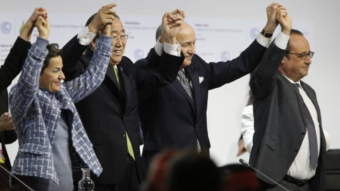 Foreign Affairs Minister and President-designate of COP21 Laurent Fabius (C), raises hands with Secretary General of the United Nations Ban Ki Moon (2-L) and France's President Francois Hollande (R) after adoption of a historic global warming pact at the COP21 Climate Conference in Le Bourget, north of Paris, on December 12, 2015. Envoys from 195 nations on December 12 adopted to cheers and tears a historic accord to stop global warming, which threatens humanity with rising seas and worsening droughts, floods and storms. AFP PHOTO / FRANCOIS GUILLOT / AFP / FRANCOIS GUILLOT        (Photo credit should read FRANCOIS GUILLOT/AFP/Getty Images)