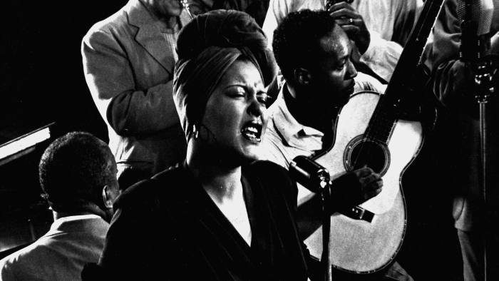 Closeup of Billie Holiday singing Fine & Mellow accompanied by James P. Johnson at piano & other unident. musicians during jam session in studio of LIFE photogrpher Gjon Mili. (Photo by Gjon Mili/The LIFE Picture Collection/Getty Images)